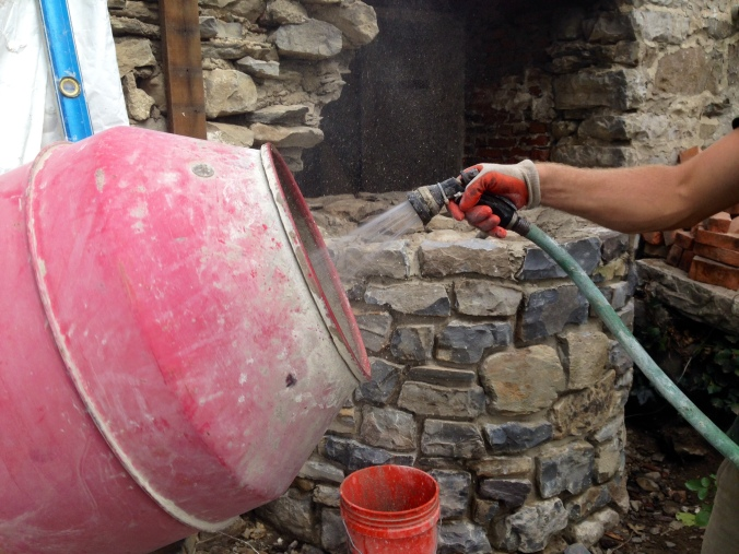 Corey Finck of Armstong Earthworks mixes Natural Hydraulic Lime mortar. Sussex, NJ.