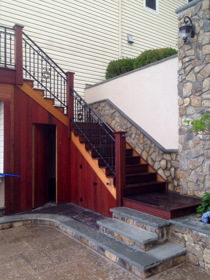 Brazilian Cherry and #1 clear cedar staircase. Stone veneer and stucco by Fullerton Lanscape Architects. Hopatcong, NJ.