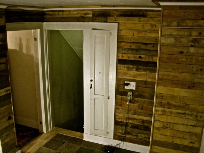 Reclaimed pallet wood wall paneling. Newton, NJ.